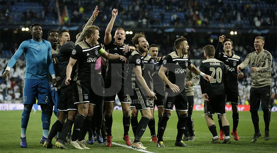 Ajax players celebrate after the Champions League round of 16 second leg soccer match between Real Madrid and Ajax at the Santiago Bernabeu stadium in Madrid