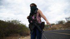 Una vigilante del grupo de mujeres de Michoacán que se enfrentan al Cartel Jalisco Nueva Generación.