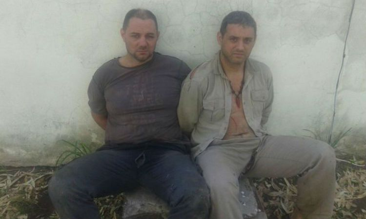 Cristian Lanatta y Víctor Schillaci al momento de ser detenidos.