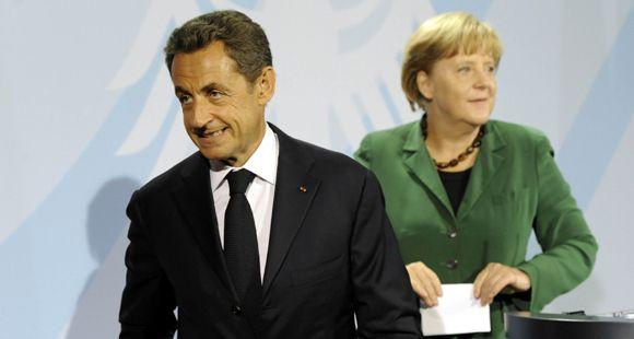 Merkel y Sarkozy tratan de blindar los bancos ante virtual default griego