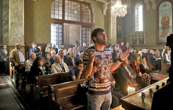 Recordación. Un rumano armenio realiza una plegaria durante un oficio religioso en Bucarest.