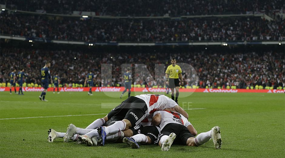Juan Quintero of Argentina's River Plate celebrates with his teammates after scoring River's second goal in overtime against Argentina's Boca Juniors during the Copa Libertadores final soccer match at the Santiago Bernabeu stadium in Madrid