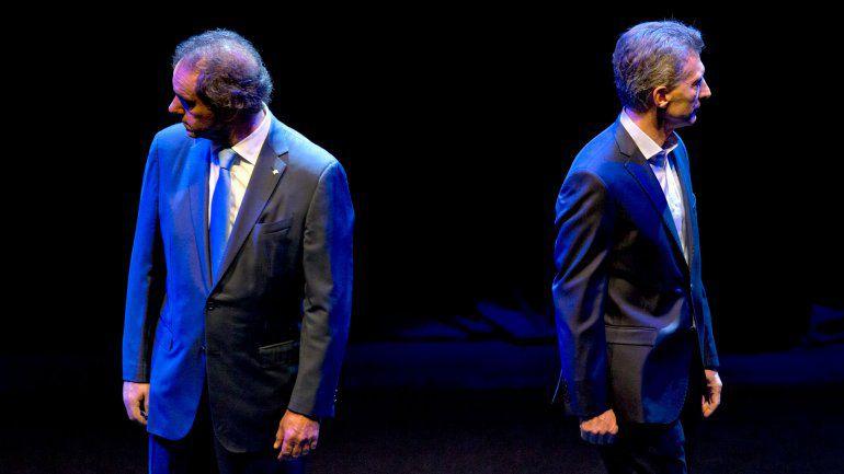 Enfrentados. Scioli dijo que salió favorecido en el debate. Macri afirmó que ya nadie le cree al kirchnerismo.