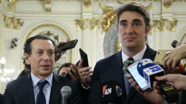 Los ministros Dante Sica y Javier Iguacel.