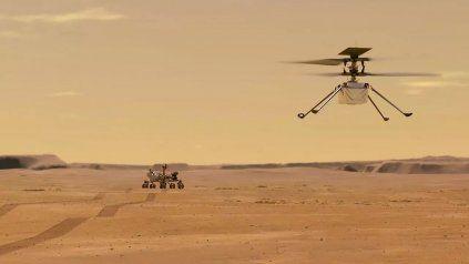 Ilustración de la NASA, mini helicóptero Ingenuity durante un vuelo de prueba en Marte.