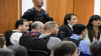 Los policías Makath, Quevertoque y Di Franco, en la primera jornada de la audiencia imputativa.