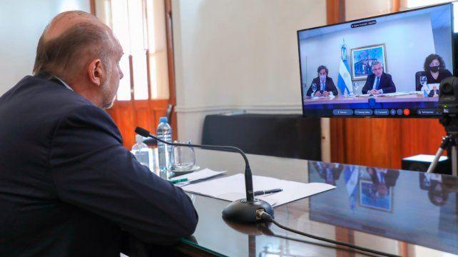 REUNIÓN VIRTUAL. Perotti y los gobernadores analizaron junto al presidente las medidas a adoptar ante el ascenso de contagios.