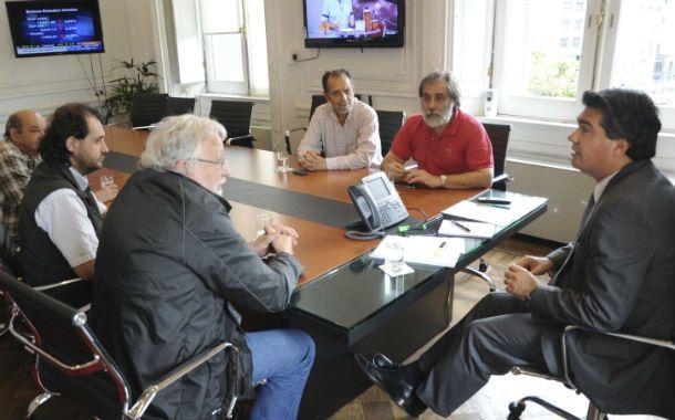 Los referentes de los gremios de prensa y la CTA junto al jefe de Gabinete en la Casa Rosada.