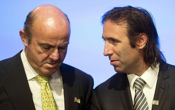 Gestiones. Lorenzino dialoga con su par español en la asamblea conjunta del FMI y Banco Mundial. ¿Hablan de Repsol?