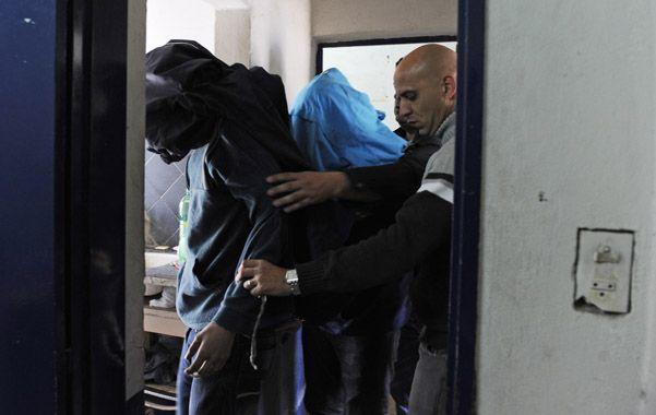 Encapuchados. Los dos detenidos estaban ayer en la comisaría 32ª.