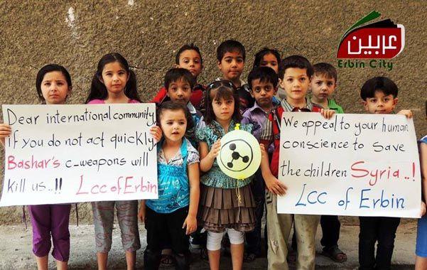 Pedido. Niños sirios le piden a la comunidad internacional que intervenga para detener a Assad y sus armas químicas.