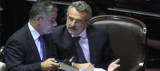 El jefe de la bancada kirchnerista junto al diputado Roberto Feletti.