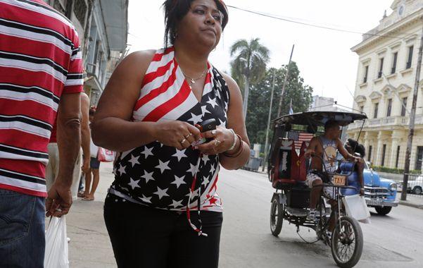 Cambios. La sociedad cubana se prepara para recibir al presidente Obama tras la apertura diplomática.