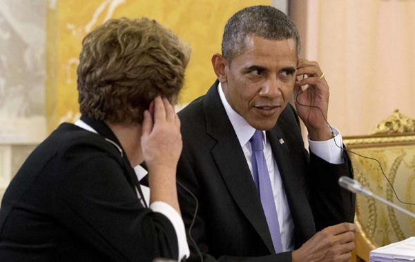 Diálogo difícil. Dilma y Obama conversaron informalmente ayer en Rusia.