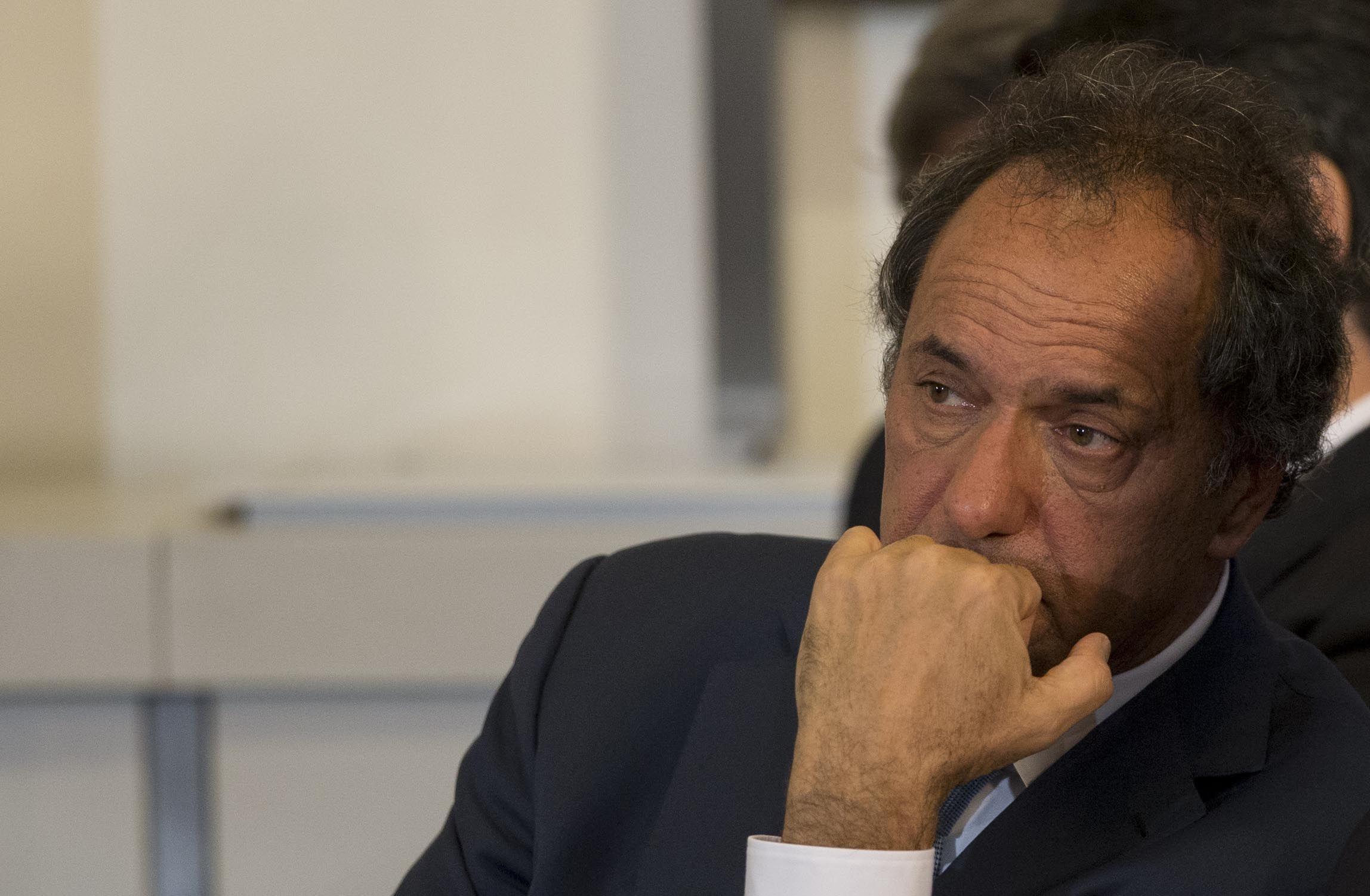 Faltazo y polémica. Scioli fue severamente cuestionado por los otros aspirantes a la Casa Rosada.