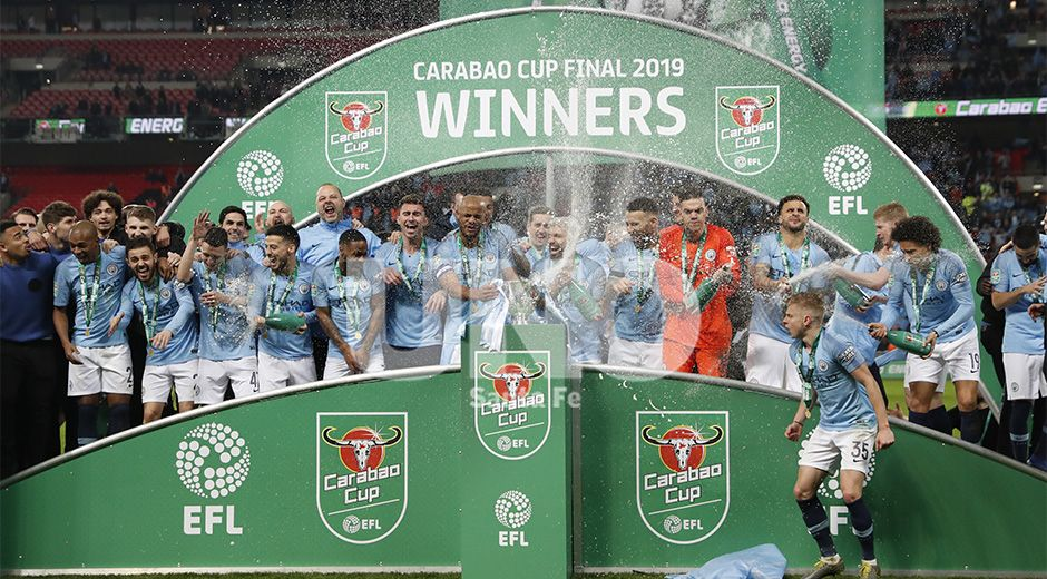 Manchester City's player celebrate after winning the English League Cup final soccer match between Chelsea and Manchester City at Wembley stadium in London