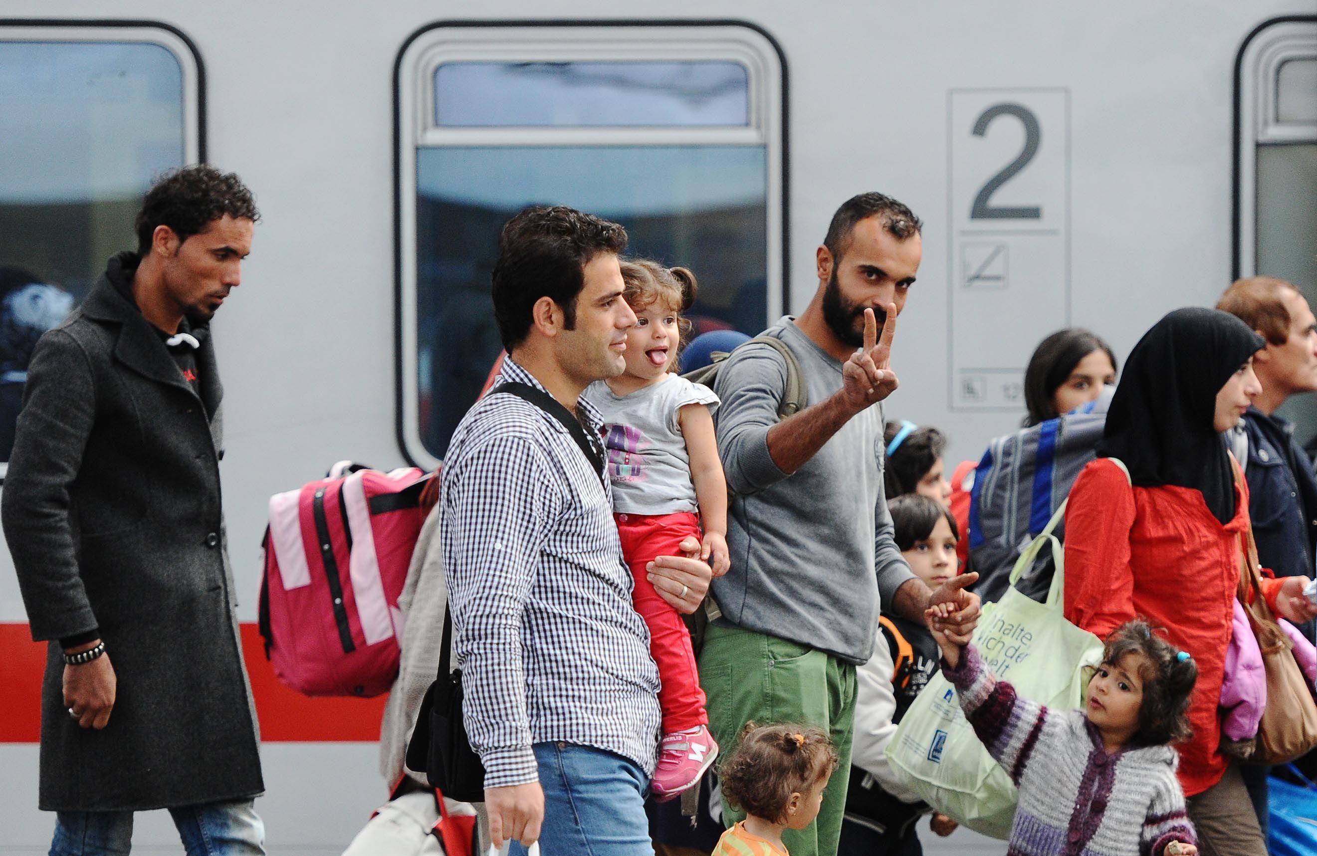 La travesía. Sirios transbordan un tren en Munich con destino a otra ciudad alemana