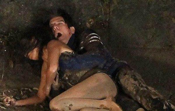 Los paparazzi captaron imágenes de la pareja revolcándose sensualmente en la tierra.