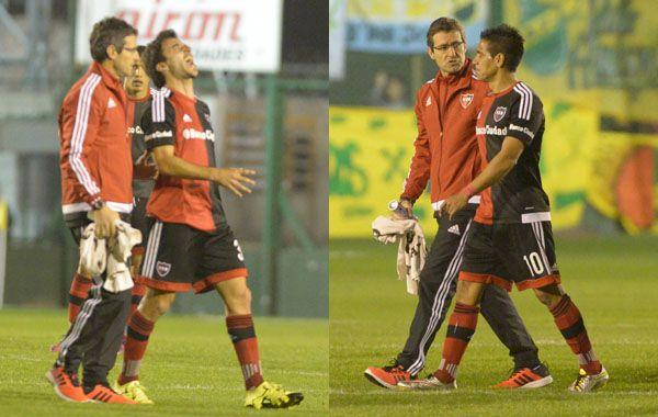 Scocco y Figueroa no pudieron completar el partido ante Defensa y Justicia.