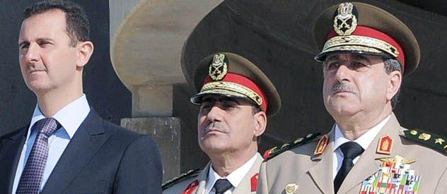 El presidente Bashar Assad (izq.) junto al ministro de Defensa (der.) muerto en el atentado de ayer.