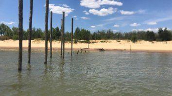 El sábado el Enapro detectó que habían saboteado el muelle que construía en la isla. En la denuncia, aportó datos sobre lotes usurpados por viviendas y paradores.
