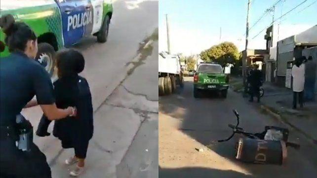Una mujer policía abriga a Maia tras encontrarla en Luján.