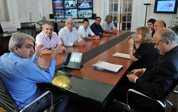 Contacto. Los ministros Fernández y Tomada recibieron ayer a la confederación de sindicatos del transporte.