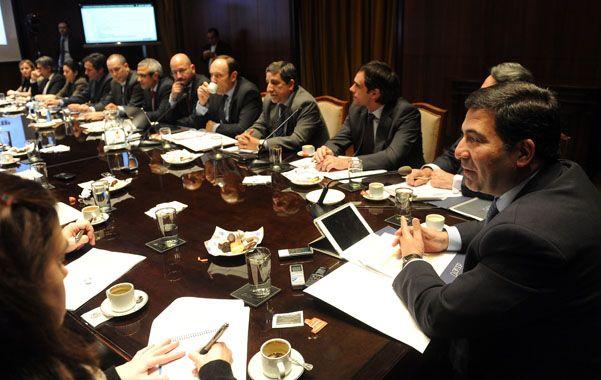Todos contentos. Echegaray se reunió con empresarios del sector inmobiliario para pulir los detalles de la norma.