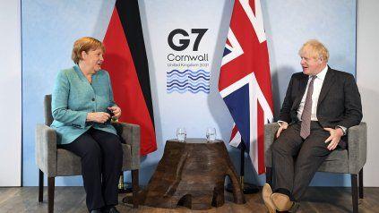 Angela Merkel junto al anfitrión del G7, Boris Johnson. La alemana es una convencida impulsora de la agenda contra el cambio climático.