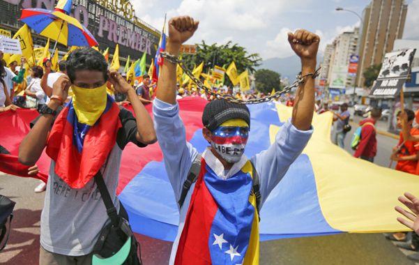 Malestar. Ayer hubo una nueva marcha de la oposición en Caracas.