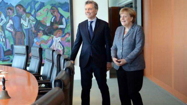 El presidente argentino y la canciller alemana.