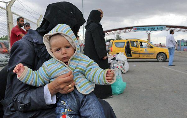 Los kurdos de Siria deben dejar sus hogares para no ser masacrados por los milicianos islamistas.