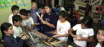 Las escuelas taller en busca de la formación específica