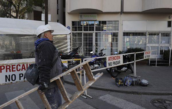 Reparaciones. Trabajos frente al local de ropa de bebés Reina Batata