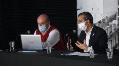 El secretario de Salud municipal, Leonardo Caruana, y el intendente Pablo Javkin.