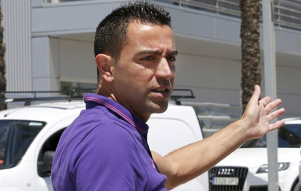 El capitán Xavi dijo que volverá al club catalán como entrenador o director deportivo.