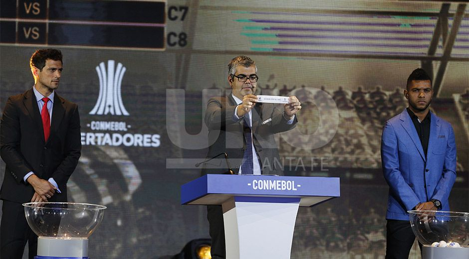 Conmebol Competition Secretary Fred Nantes holds up the name of Uruguay's Defensor Sporting during the drawing ceremony for the Copa Libertadores soccer tournament in Luque