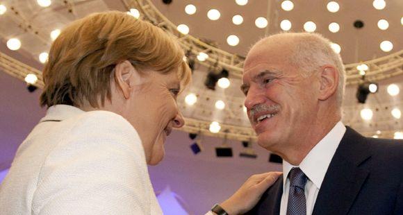 Merkel y Papandreu defienden el rescate griego frente a los escépticos