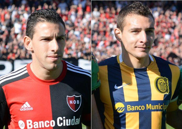 El volante ofensivo leproso Maxi Rodríguez y el delanero canalla Marco Ruben.