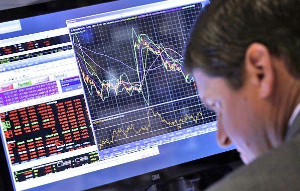 Para abajo. Los operadores de la Bolsa de Nueva York asistieron a otra jornada negativa en Wall Street.