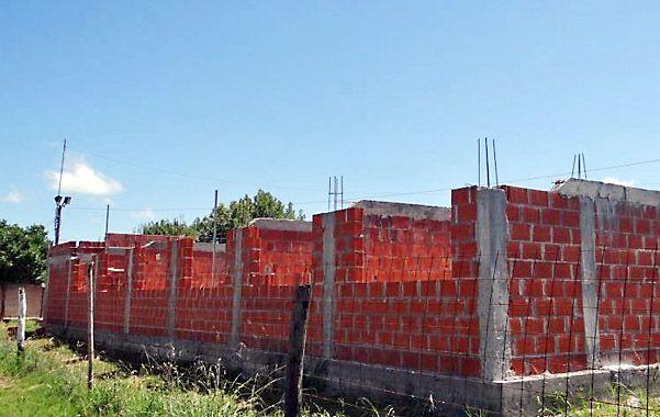 Plena labor. La construcción llega a la altura de los dinteles de las ventanas.