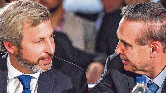 Cara a cara. El ministro Frigerio y el senador Pichetto discuten el recorte de fondos a las provincias.