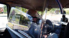 DEFENSA. El cristal separa al conductor del pasajero, para evitar que el trabajador quede expuesto desde su espalda mientras va manejando.