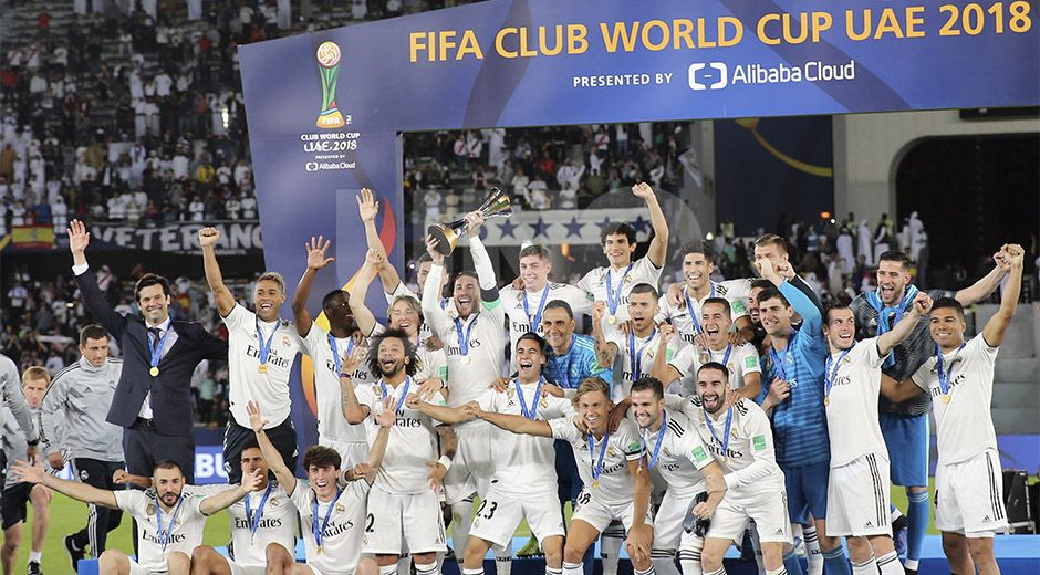 Real Madrid celebrate with the trophy after winning the Club World Cup final soccer match between Real Madrid and Al Ain at Zayed Sport City in Abu Dhabi