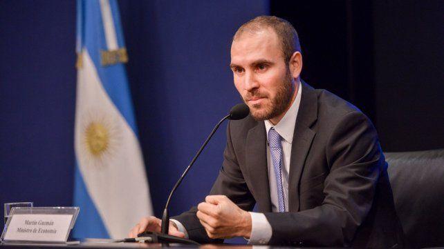 Garantías. Guzmán tranquilizó al mercado al plantear un plan para reactivar la economía.
