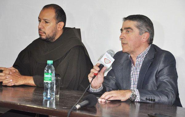 El padre Duarte y el senador Traferri.
