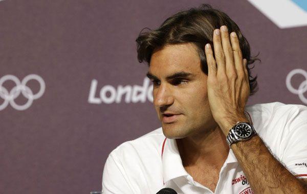 Federer dió una conferencia de prensa en el auditorio principal del centro de prensa colmado de periodistas y público. (Foto: AP)