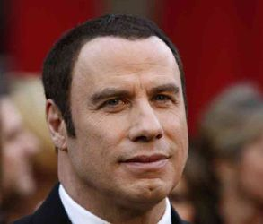 Paramédico acusado de extorsionar a Travolta con foto de su hijo agonizando