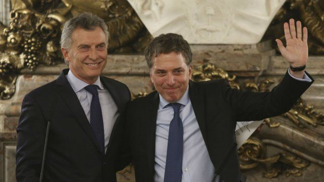 Macri y el exministro Dujovne. La política económica afectó a la mayor parte del electorado.