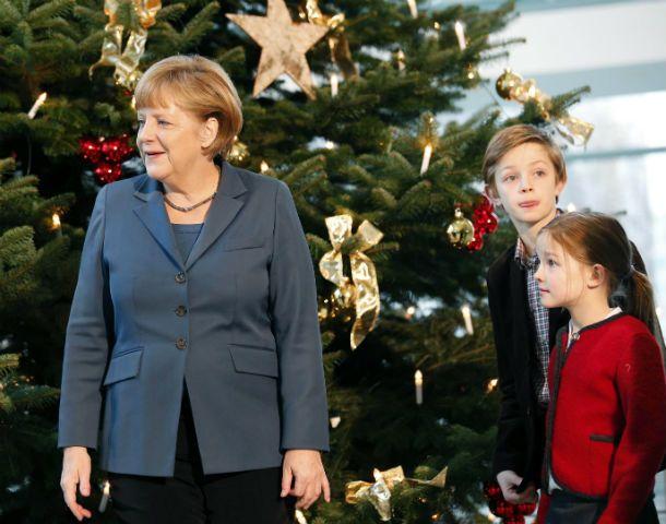 Fiesta. La canciller germana podría asumir su tercer gobierno para Navidad.